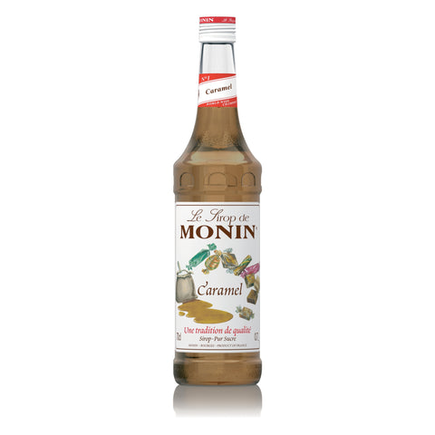 A 70cl glass bottle of MONIN Caramel Syrup.