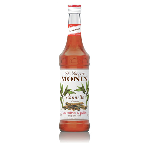 A 70cl glass bottle of MONIN Cinnamon (Cannelle) Syrup.