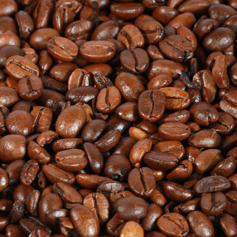 1 kilo black bag of Coffee Care's Monsoon Malabar Coffee Beans. Freshly roasted Indian Coffee