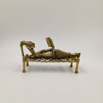 Reading Lady reclining posture on cot