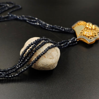 Black crystal beads necklace with ornate metal pendant