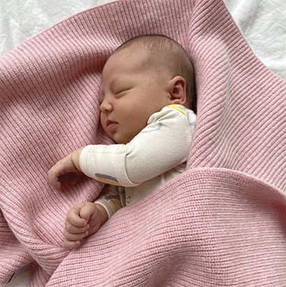 Organic plant dyed nontoxic baby blanket. Ethically made in the USA. Sustainable organic merino wool baby blanket. Marled grey unisex gender neutral baby gift. GOTS and OEKOTEX certified. Luxury baby blanket. Organic pink baby blanket made in the USA.