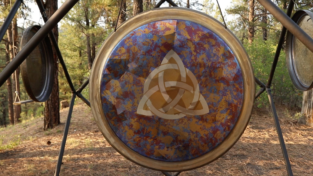 Playing the gong can help create understanding through duality.