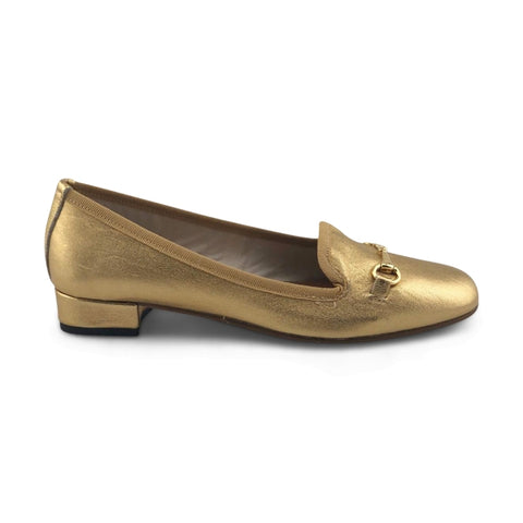 Woman slipper in gold laminated leather with horsebit