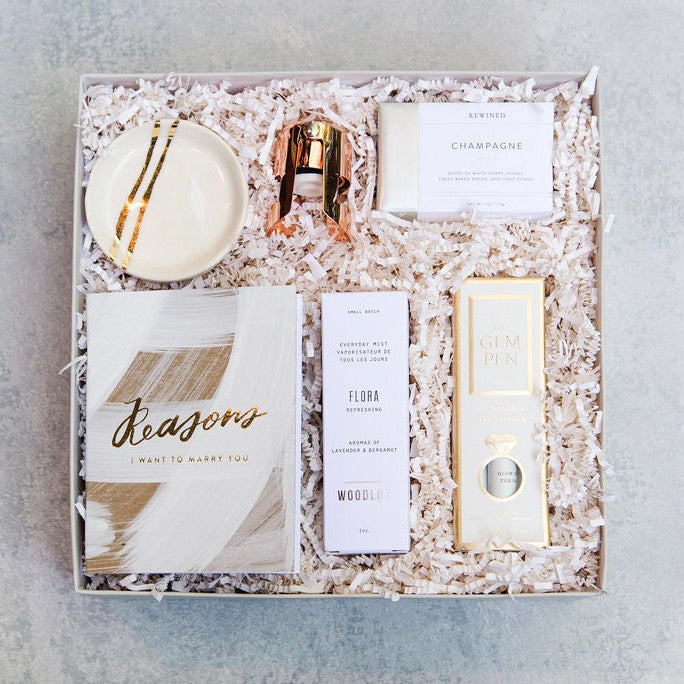 Our Blushing Bride Box is the perfect way to congratulate a new bride-to-be! Whether you have seen the ring in person or are sending your love from afar, this gift is sure to make her blush. Wedding Gift Box.