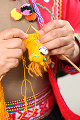 knitting a finger puppet