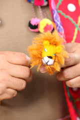 hand knitting a finger puppet from Peru