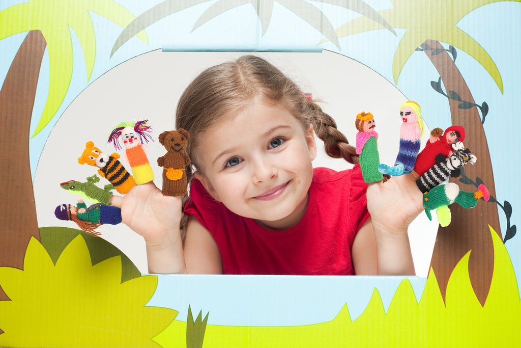 happy child, playing with finger puppets