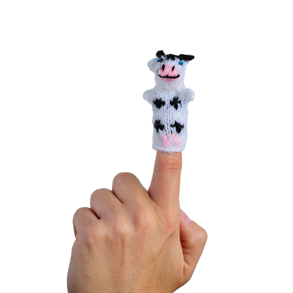 baby bovine cow finger puppet on a finger