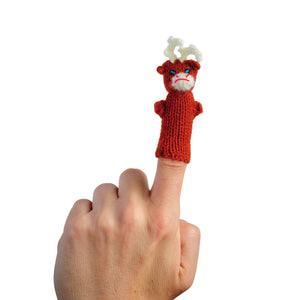 cranky baby reindeer finger puppet on a finger