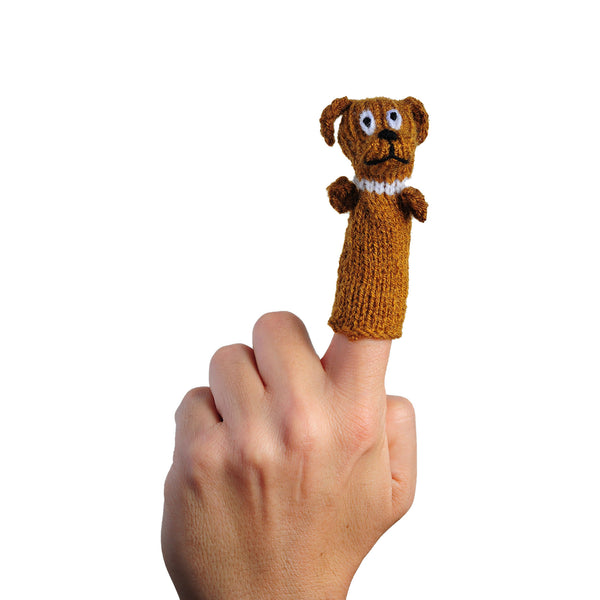 brown dog finger puppet on a person's finger