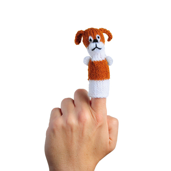 brown and white dog finger puppet on a finger