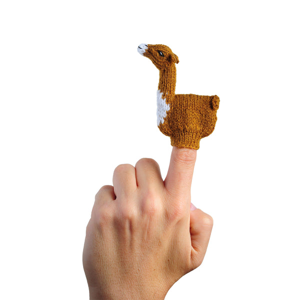 Llama finger puppet on a person's finger