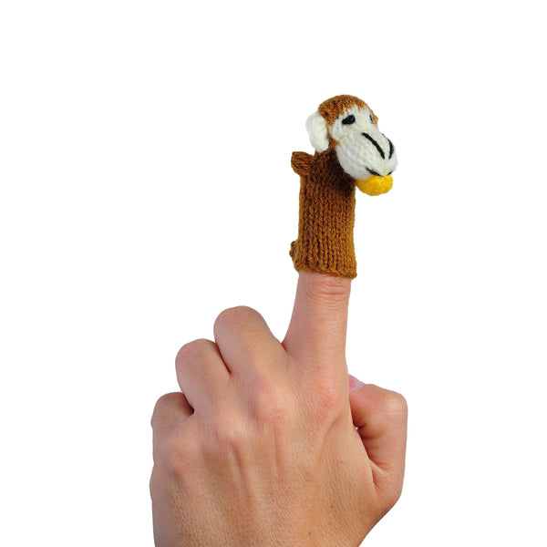 monkey finger puppet on a finger