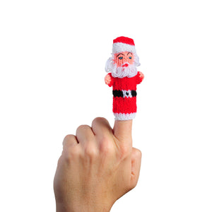 santa clause finger puppet on a finger