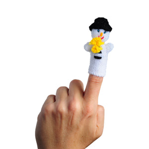 snowman wearing a yellow scarf finger puppet on a person's finger
