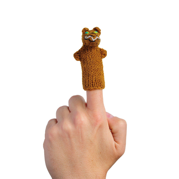 wolf finger puppet on a finger