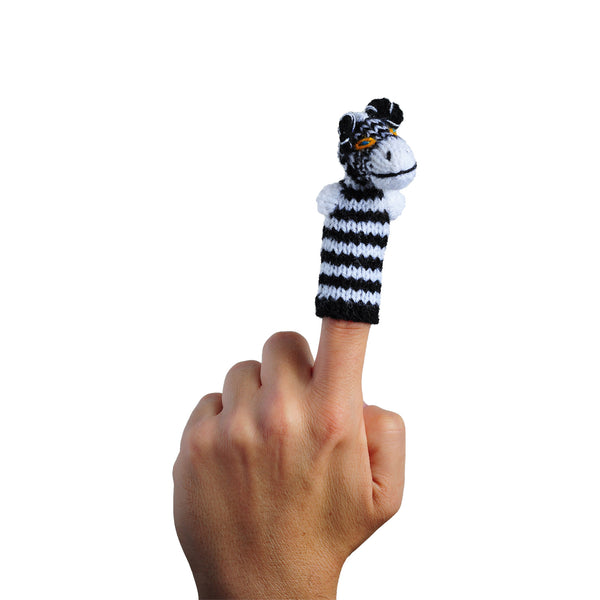 zebra finger puppet on a finger