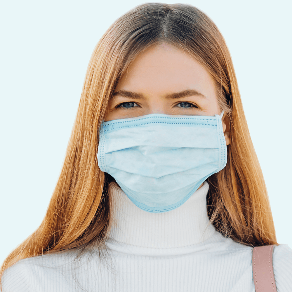 woman wears blue disposable face mask