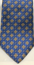 Load image into Gallery viewer, Tom James Men's Royal Classic Silk Tie. Light blue and golden/antique yellow, accents ,tri foil and diamond motifs. $47.50
