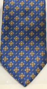 Tom James Men's Royal Classic Silk Tie. Light blue and golden/antique yellow, accents ,tri foil and diamond motifs. $47.50