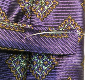 Tom James Men's Tie, Fine Silk Twill Purple Bronze and Grey accents, Diamond and Floral repetitive pattern.  $47.50