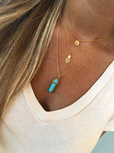 turquoise/howlite gemstone pointed pendant necklace.