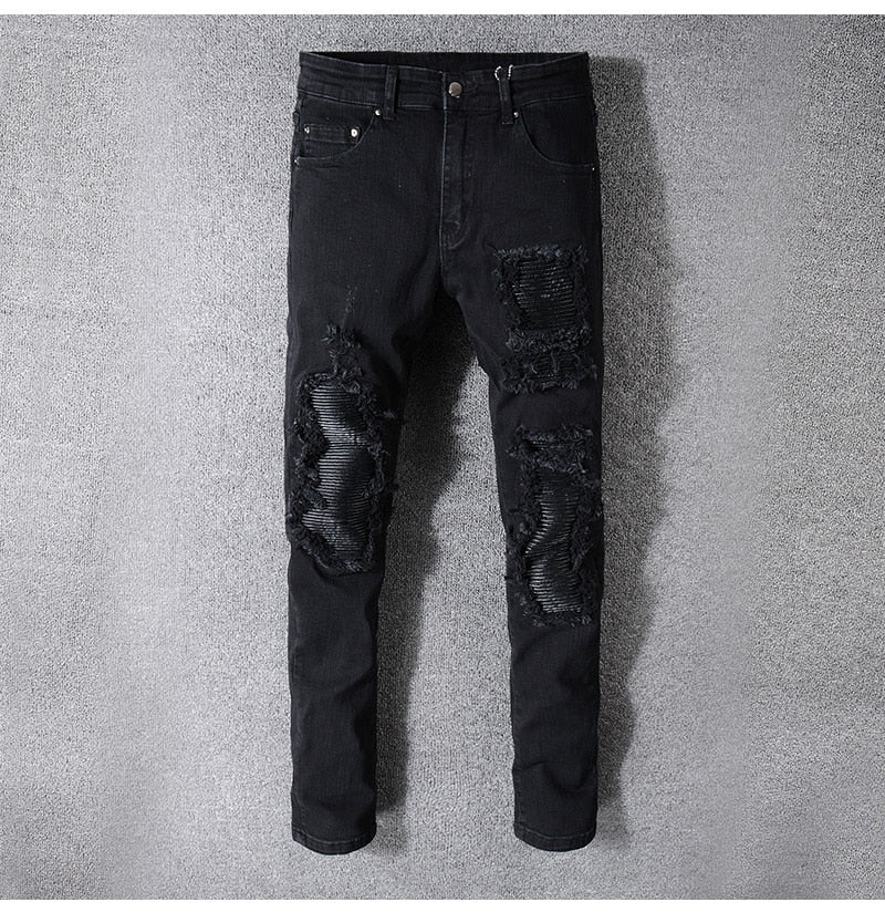SKINNY-FIT DISTRESSED LEATHER-PANELLED DENIM JEANS - BLACK