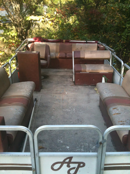 Used pontoon boat in need of new furniture and deck