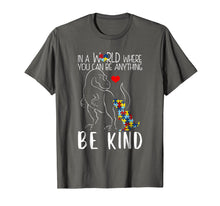 Load image into Gallery viewer, In A World Where You Can Be Anything Be Kind Dinosaur TShirt