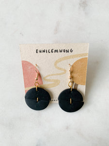 black discs — dangle earrings