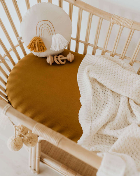 Bronze Fitted Bassinet Sheet multipurpose Change Pad Cover for your convenience. Made from soft, stretch cotton jersey, it fits cane bassinets. Style your nursery with bronze bassinet sheet multipurpose change pad cover