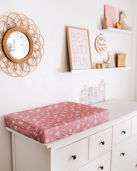 Daisy Fitted Bassinet Sheet multipurpose Change Pad Cover for your convenience, comes with drawstring bag. Made from soft, stretch cotton jersey, it fits cane bassinets. Style your nursery with bronze bassinet sheet multipurpose change pad cover. white daisy print on pink