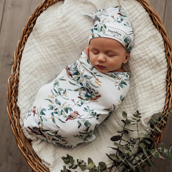 Eucalypt Snuggle Swaddle Beanie Set. Swaddled baby for birth announcement photo. Swaddle sack comes with a matching knotted beanie. Eucalypt Swaddle is perfect as newborn gift. Fits baby 2.5kgs-6kg