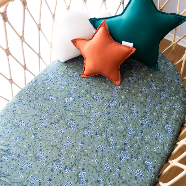 Our fitted cot sheets are soft and breathable, 100% cotton. Perfect for your sleeping baby. Fits Australian cot up to 135cm x 75cm, cot sheets feature a fully encased elastic and fit Boori cots. Print has fine flowers on a deep olive green background.