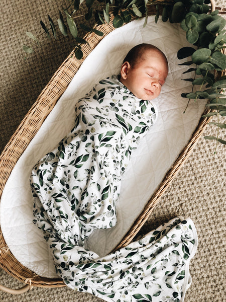 The Golden Leaves swaddle comes with a matching beanie. It is 100cm x 100cm Soft and breathable. The stretch swaddle wrap with matching beanie is made from 95% cotton and 5% Spandex. Our organic cotton swaddle wraps have the perfect amount of stretch to keep your babies snug during sleep. Golden leaves print has white background with deep green leaves or foliage.