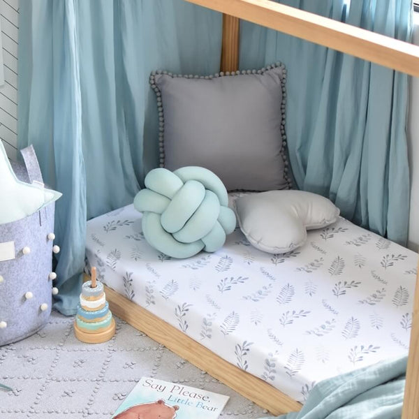 Snuggle Hunny Kids Wild Fern Fitted Cot Sheet made from snuggly soft stretch cotton jersey. Fits Australian cots including Boori cot. Comes with a matching drawstring storage bag. Style your gender neutral nursery. Perfect newborn gift or expecting mum. Crease free, soft breathable cotton