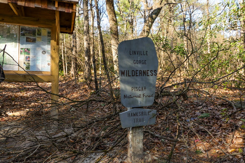 hiking trail sign for hawksbill mountain in linville gorge wilderness