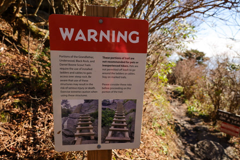 warning signs along the grandfather trail on grandfather mountain
