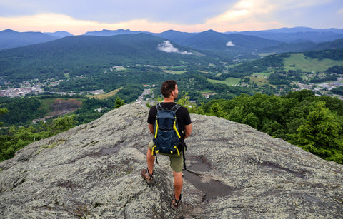 hiker standing on jefferson overlook in mount jefferson state natural area