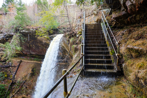 Staircase flooded from waterfall in broke leg falls waterfall scenic area kentucky