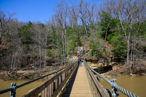 Crossing the suspension bridge in Turkey run state park into Rocky hollow falls canyon nature preserve Indiana