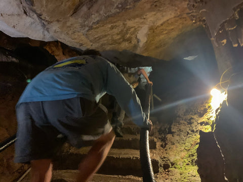 climbing through narrow passagways in tuckaleechee caverns, tennessee