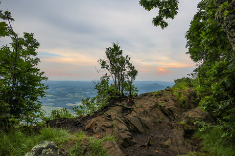 luther rock and sunset behind blue ridge mountains in mount jefferson state natural area