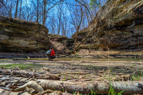 hikers viewing distant waterfall in portland arch nature preserve indiana