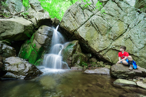 Hiker looking out over Middle falls of Glen falls trail in Lookout Mountain Tennessee