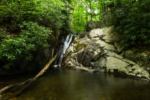 cascading waterfalls along cabin creek trail in grayson highlands state park in virginia