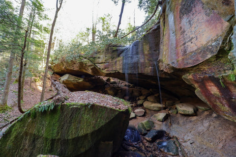 waterfall streaming over whittleton arch in red river gorge kentucky
