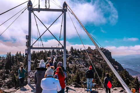 queuing up to cross the mile high swinging bridge on grandfather mountain