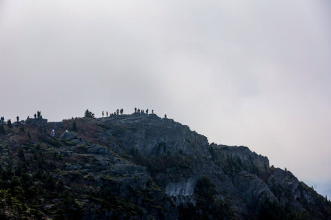 hikers atop of linville peak on grandfather mountain